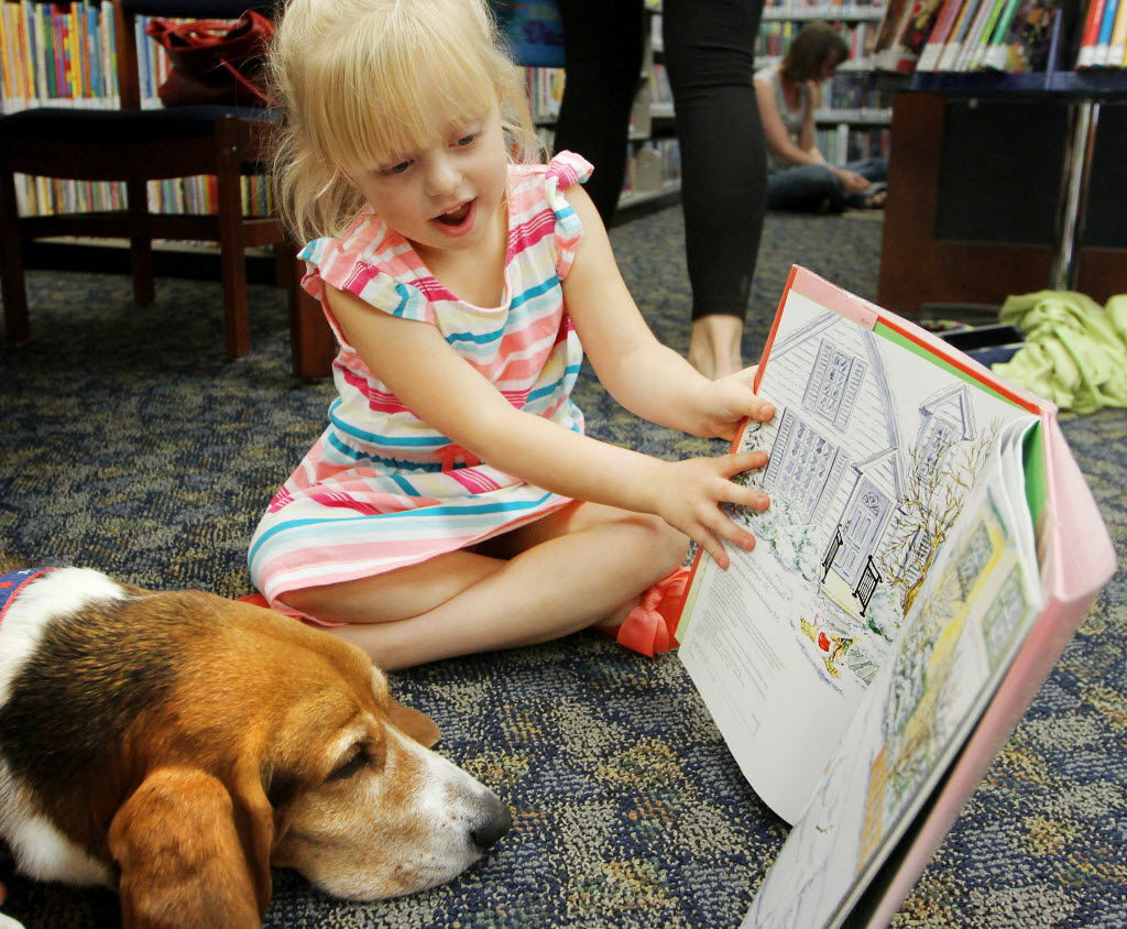 Davenport library: Kids learn to read better with dogs ...