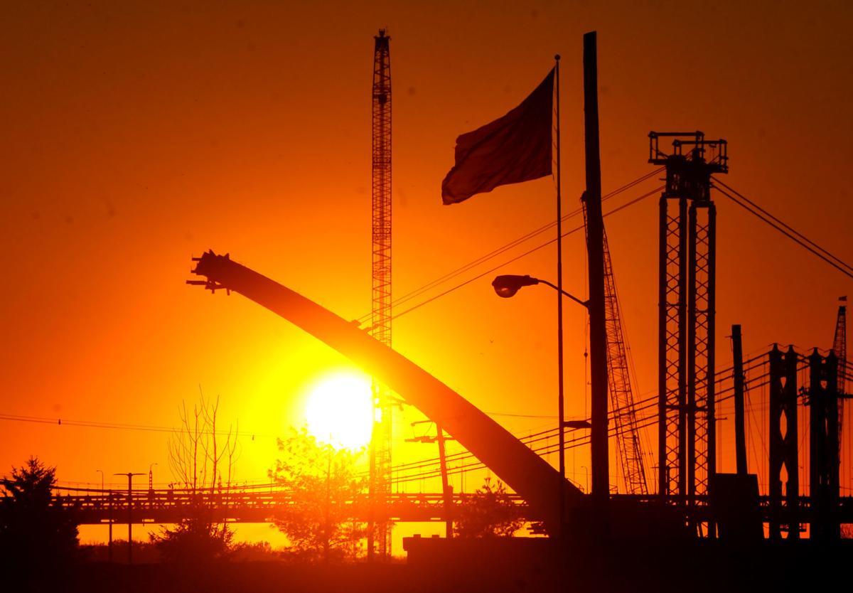 Sunset behind the new Interstate 74 bridge construction in Bettendorf.