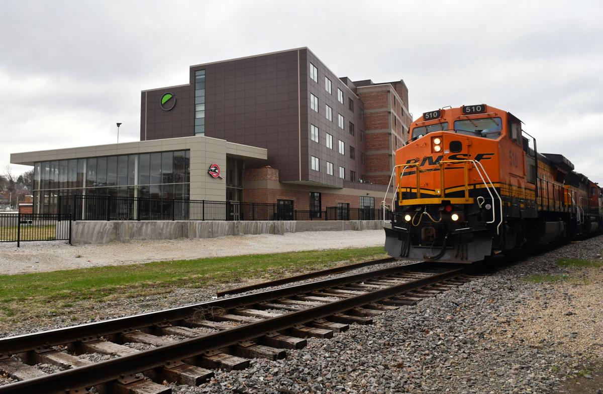 Train rolls past The Q in downtown Moline.
