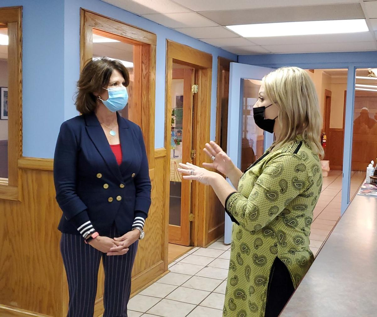 Cheri Bustos and Laura Fontaine