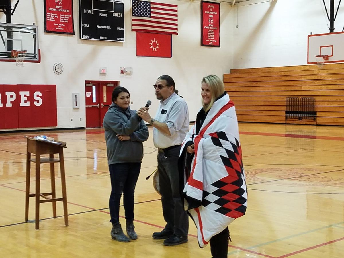 DeAnn Heline was presented with a Star Quilt at Pine Ridge High School