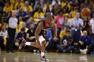 OAKLAND, CALIFORNIA - MAY 08:   Chris Paul #3 of the Houston Rockets goes for a loose ball against the Golden State Warriors during Game Five of the Western Conference Semifinals of the 2019 NBA Playoffs at ORACLE Arena on May 08, 2019 in Oakland, California.  NOTE TO USER: User expressly acknowledges and agrees that, by downloading and or using this photograph, User is consenting to the terms and conditions of the Getty Images License Agreement.