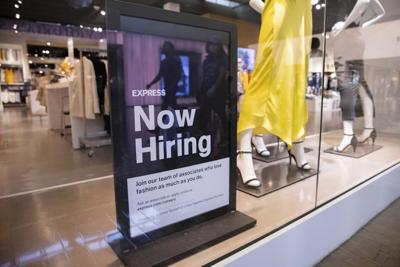 A hiring sign at Express at NorthPark Center on Friday, May 28, 2021, in Dallas.