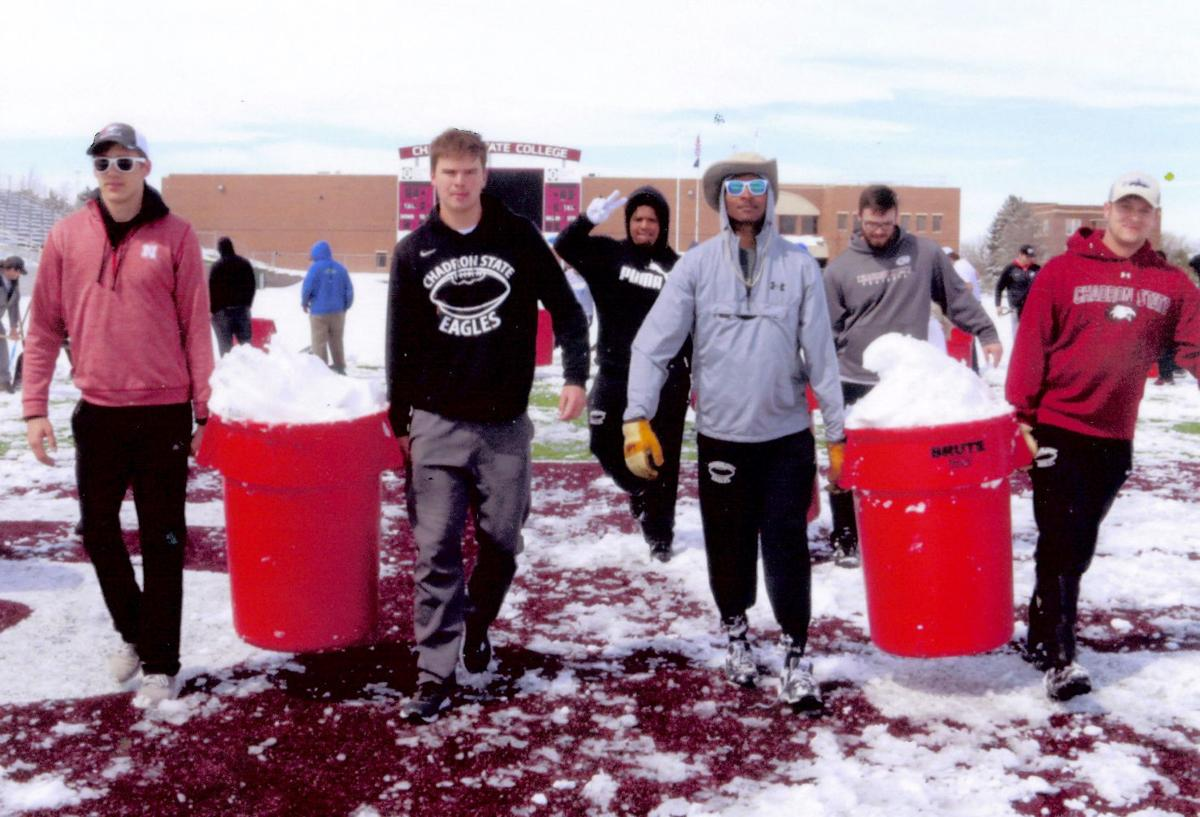 Players spend Friday cleaning up field