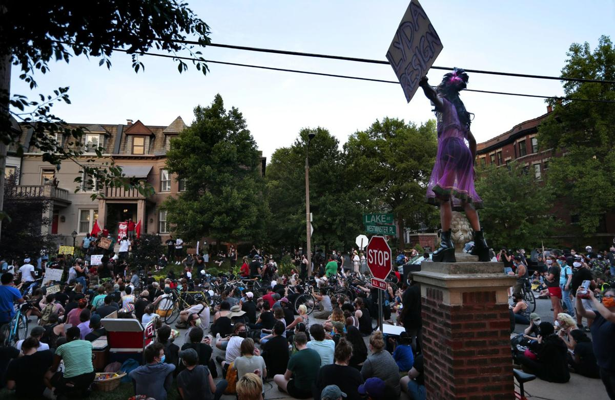 Protesters march to mayor's house