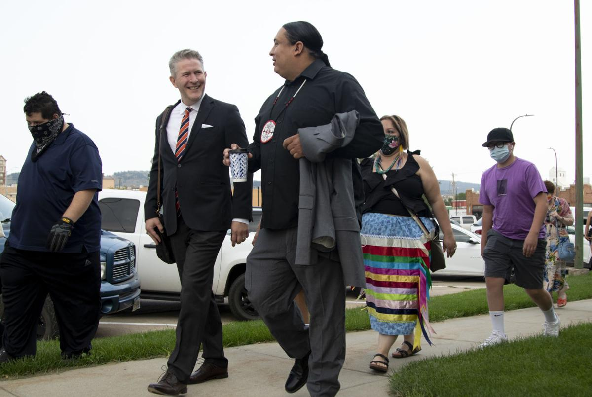 PHOTOS: Supporters walk with Nick Tilsen to preliminary hearing