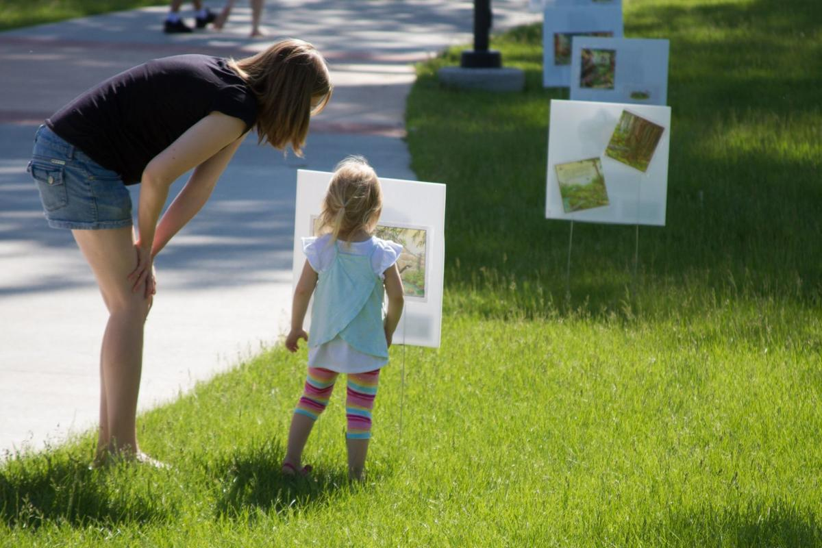 Girl and Mother at Story Walks program.jpg