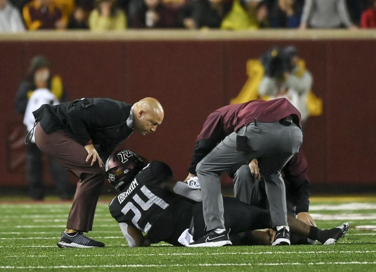 Minnesota Gophers head coach P.J. Fleck checks on Minnesota Golden Gophers running back Mohamed Ibrahim after he was injured in the second half against the Ohio State Buckeyes.