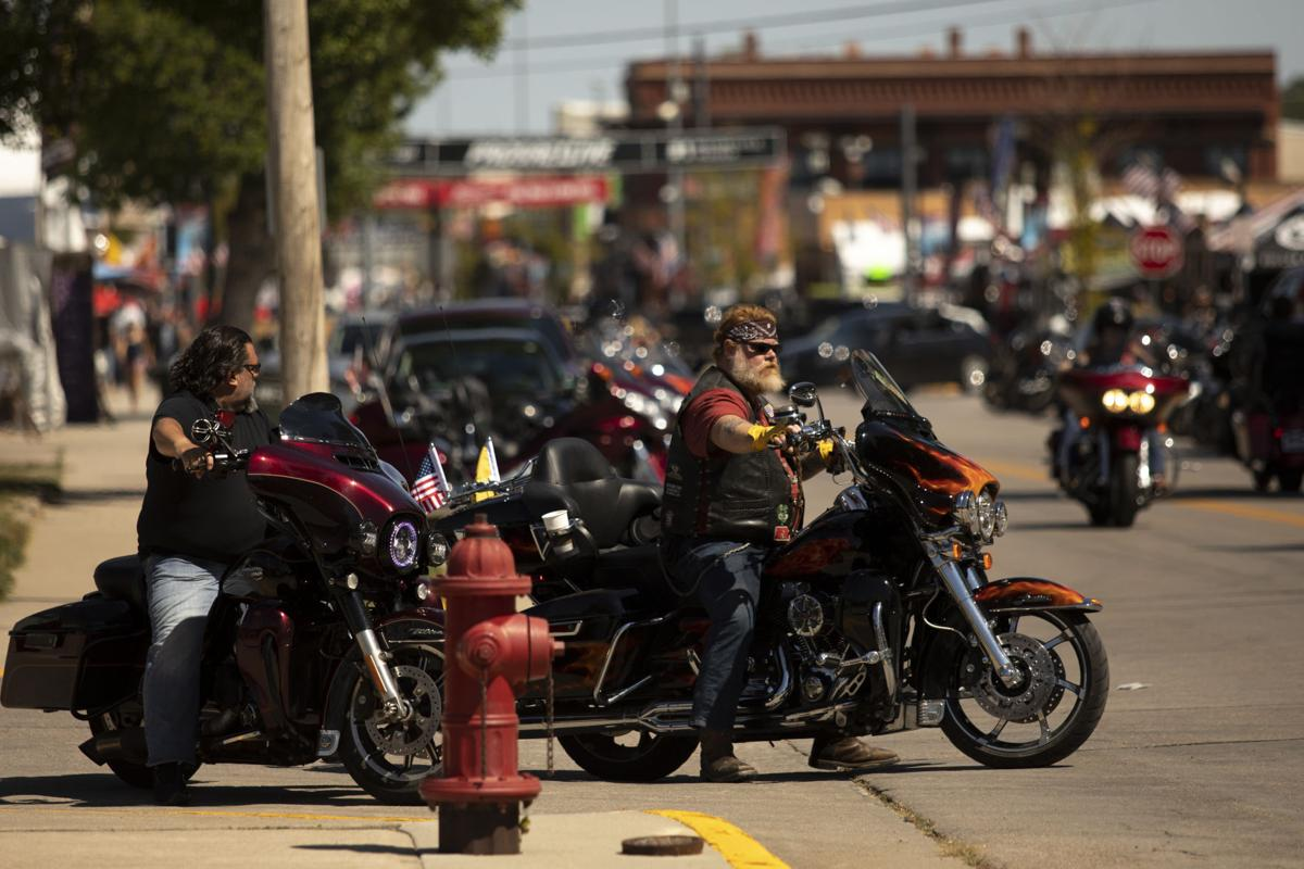 Motorcycles Ride Through Downtown