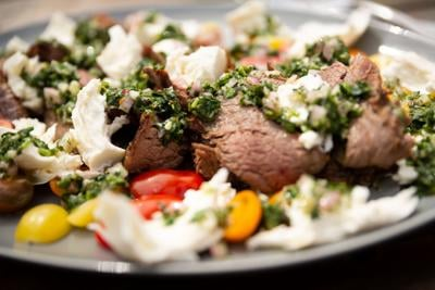 This grilled flank steak salad with chimichurri should be added to your summertime menu today