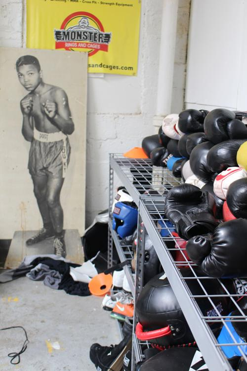 Boxing gloves and other pugilistic gear at Louisville TKO Boxing await young people who, like the pictured 12-year-old Cassius Clay, dream of someday being the greatest -- or at least pretty good.