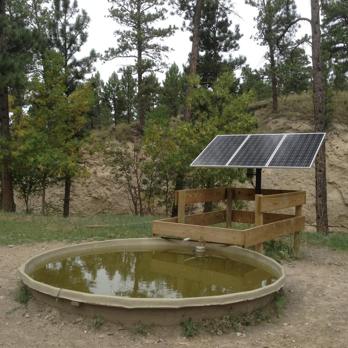 Anderson's solar powered well.JPG