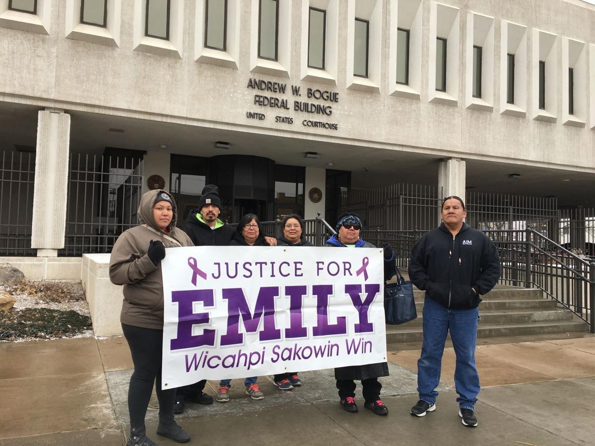 Emily Bluebird's family and friends outside the federal courthouse in Rapid City