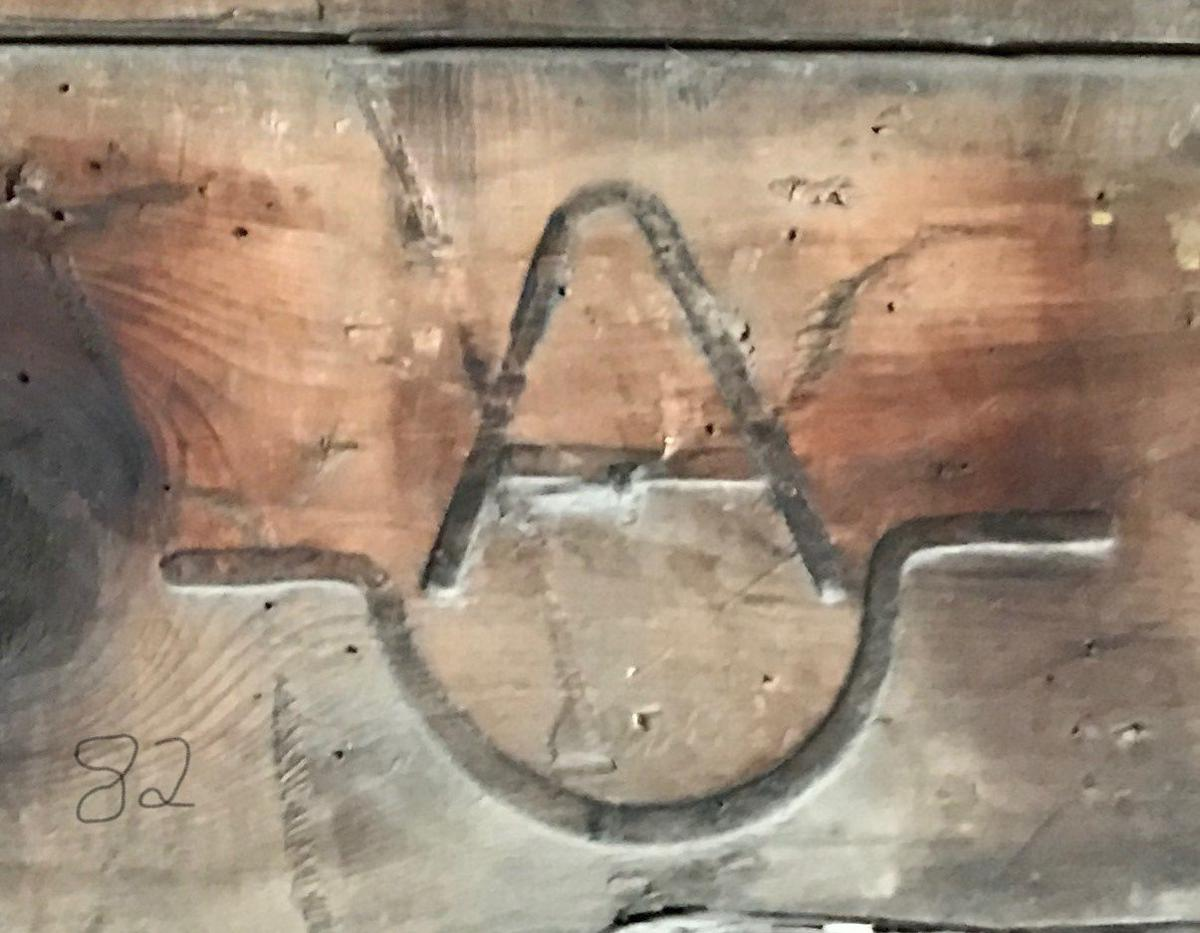Blacksmith shop wall chronicles early brand history