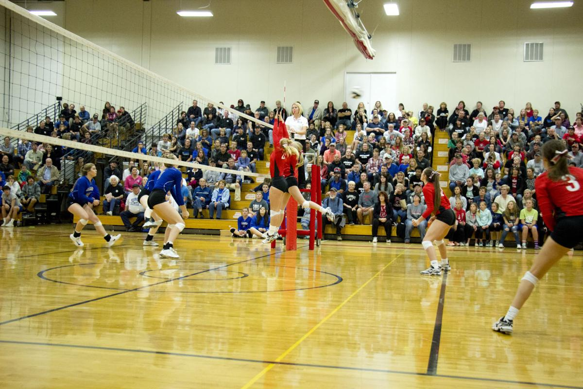 Chadron players narrowly miss a block Tuesday night against Alliance.