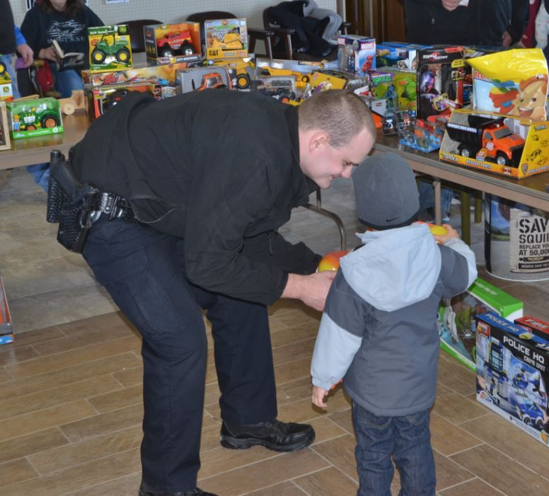 Jacobson helps pick a toy