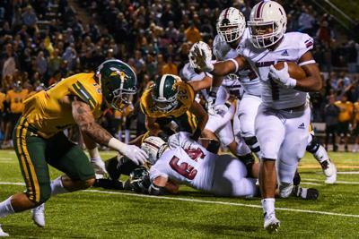 Elijah Myles runs toward endzone