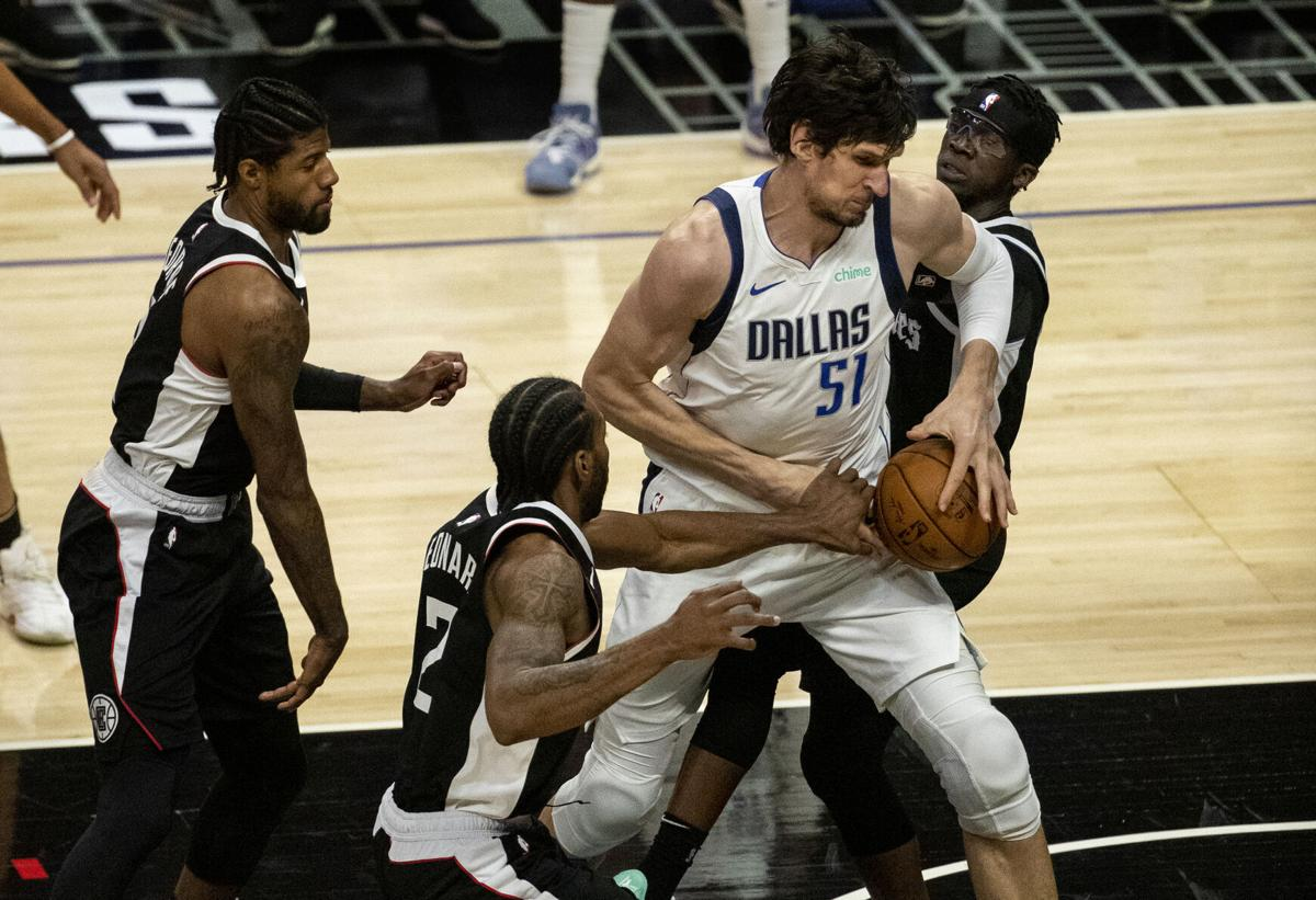Los Angeles Clippers forward Kawhi Leonard and guard Reggie Jackson go for the steal against Dallas Mavericks center Boban Marjanovic in the first half of game seven of the first round of the NBA Playoffs at Staples Center on Sunday, June 6, 2021 in Los Angeles, California.