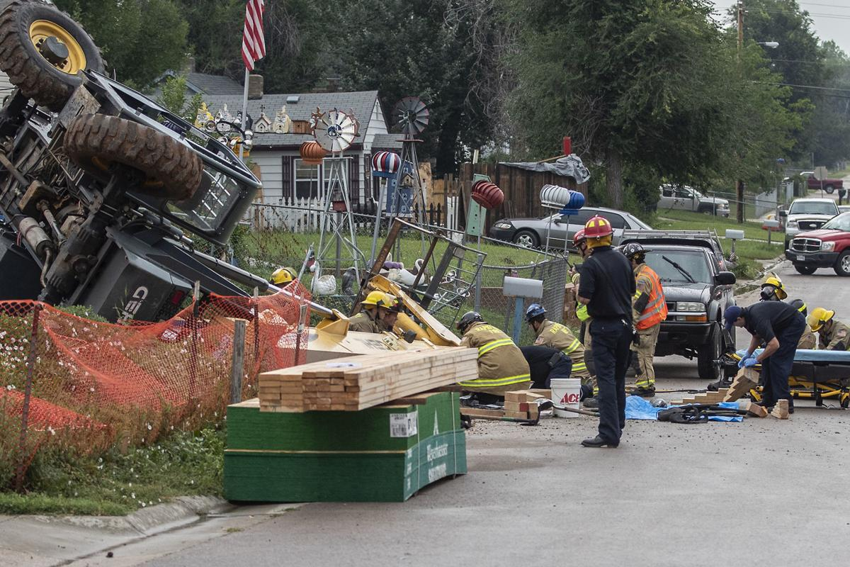 Woman rescued after being trapped under forklift at Rapid