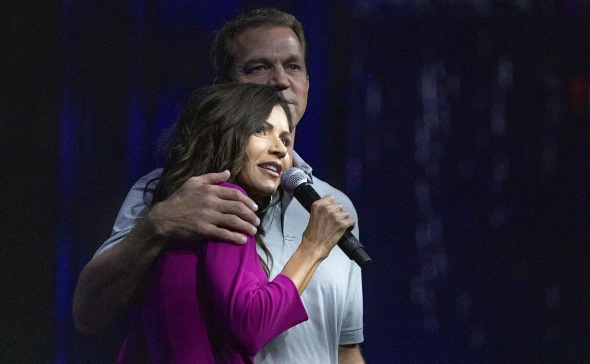 Noem embraces husband