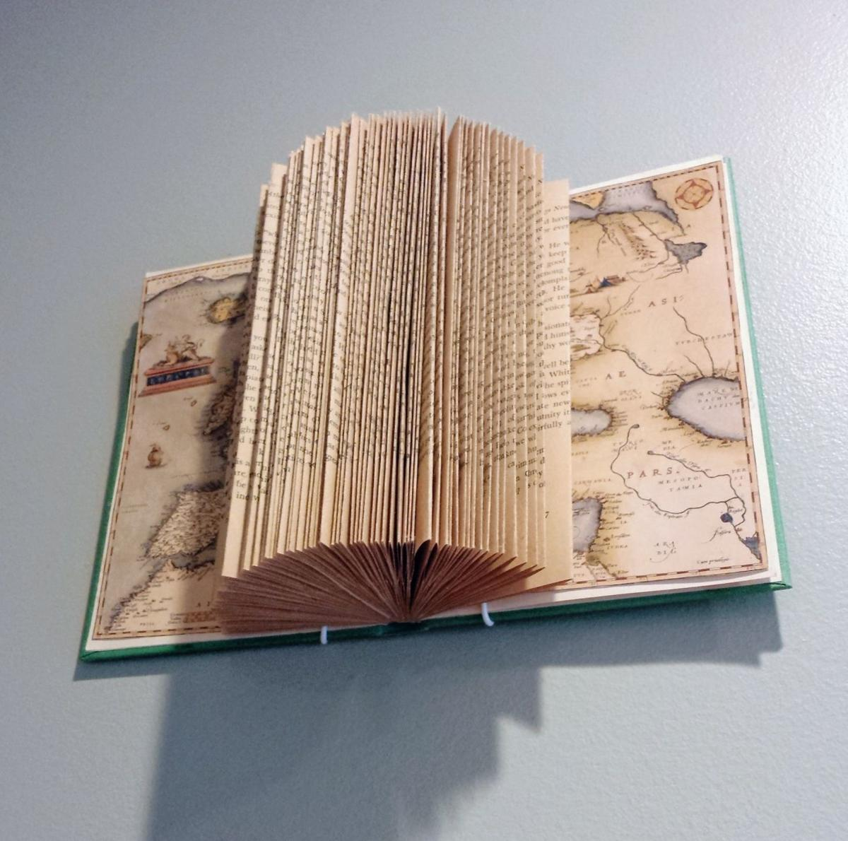 A new use for an old book? Fold it into a work of art