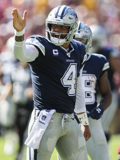 Dallas Cowboys quarterback Dak Prescott (4) signals a first down during the second quarter against the Washington Redskins on September 15, 2019, at FedExField in Landover, Md.