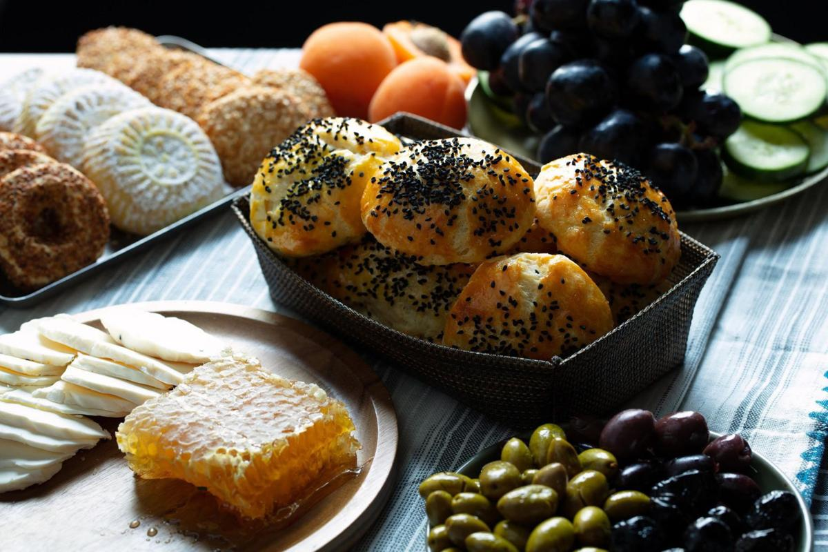 A typical Turkish breakfast spread includes a bevy of cheese, olives, local honey, fruits and baked goods like pogaca and gazleme.