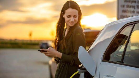 EV charging woman