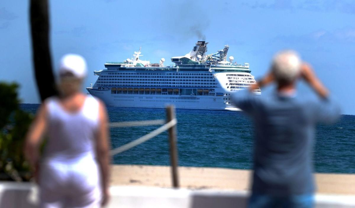 """The Royal Caribbean ship Adventure of the Sea sits off Fort Lauderdale beach on Thursday, April 2, 2020. The cruise line's parent company announced Thursday, July 30, 2020, it was dropping """"cruises"""" from its official name to become Royal Caribbean Group. The cruise ships are ready to set sail again after the pandemic shut down its operations."""