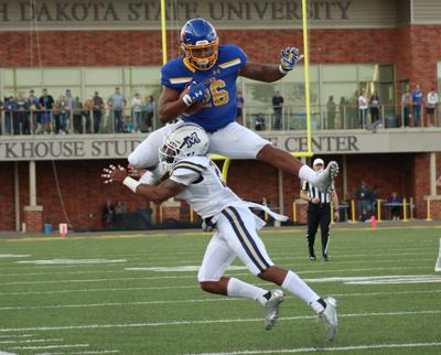 Junior running back Mikey Daniel (26) hurdles over Montana States Tyrel Thomas (2) during the SDSU vs. Montana State game of Saturday, Sept. 8 at Dana J. Dykhouse Stadium in Brookings, S.D. The SDSU Jackrabbits beat the Montana State Bobcats 45-14 and will return at 6 p.m. Saturday, Sept. 15 to Dana J. Dykhouse against the Arkansas-Pine Bluff Golden Lions.