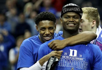 Duke eammates RJ Barrett, left, and Zion Williamson react after defeating Florida State in the championship game of the ACC Tournament at Spectrum Center in Charlotte, N.C., on March 16, 2019. **FOR USE WITH THIS STORY ONLY**