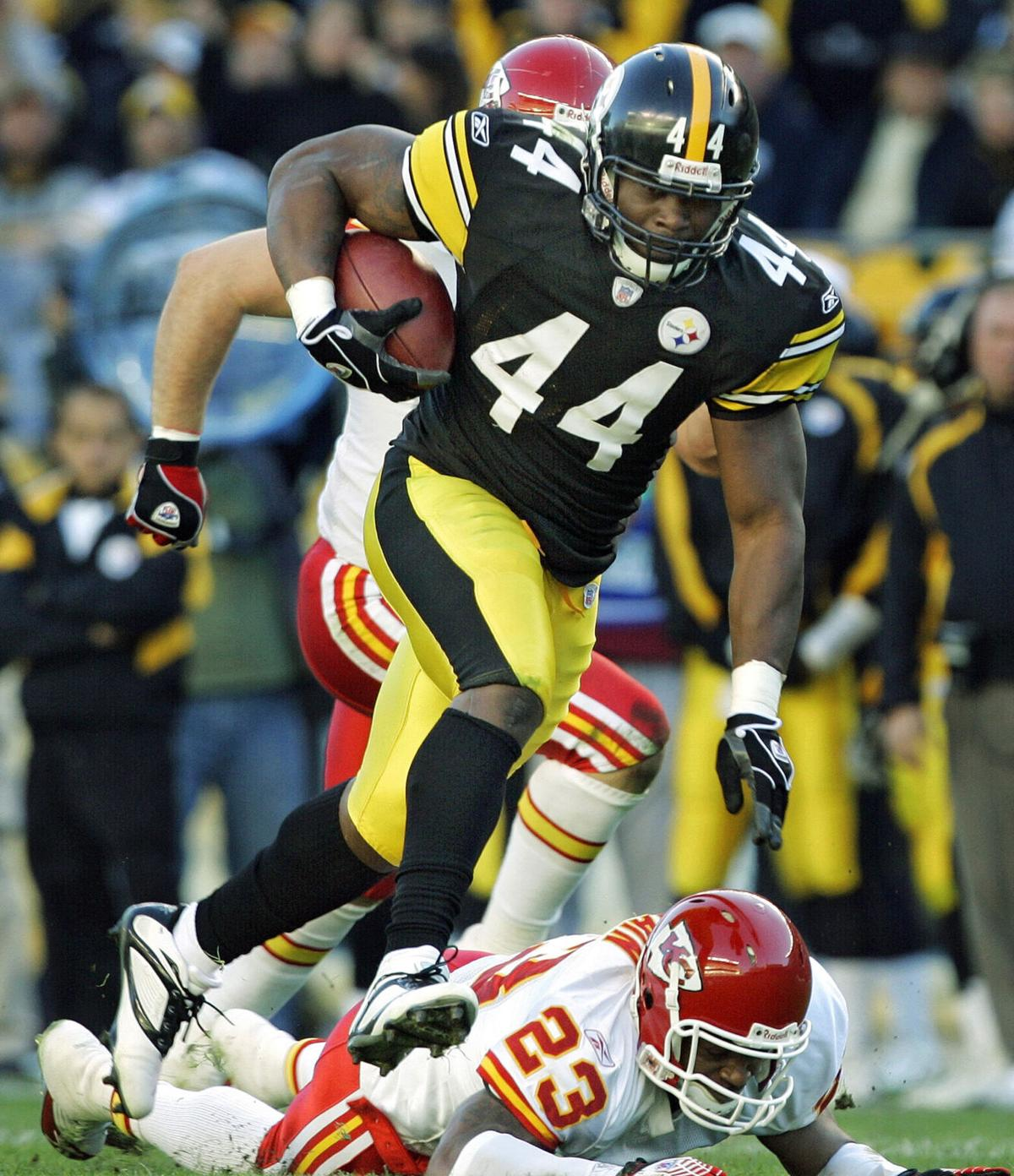Pittsburgh Steelers running back Najeh Davenport steps over Kansas City Chiefs' Patrick Surtain on a 48- yard run in the second quarter, at Heinz Field in Pittsburgh, Pennsylvania, Sunday, October 15, 2006.