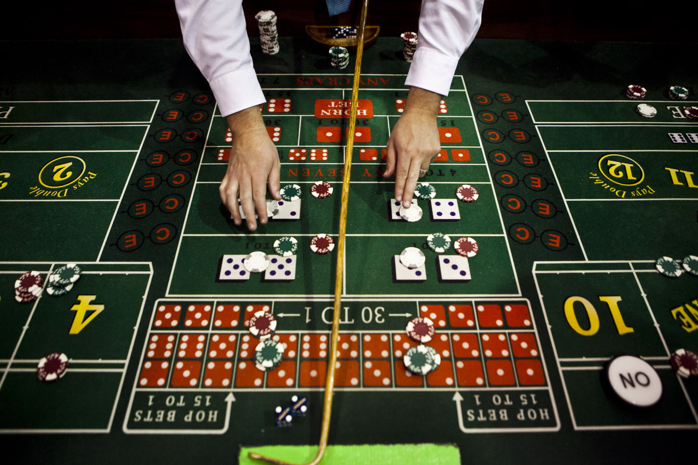 Casino bones crossword clue