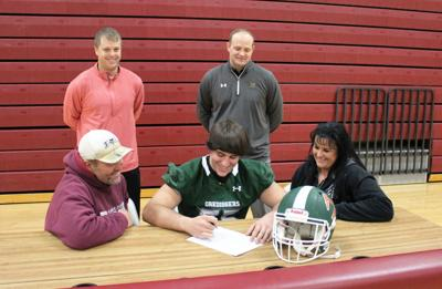 Signing Coy White