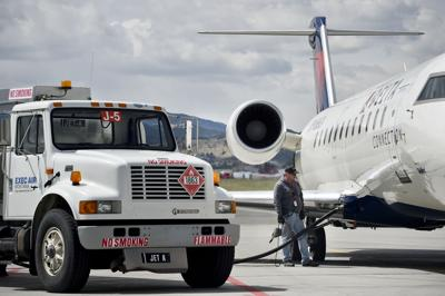 A commercial Delta Airlines airplane is fueled up