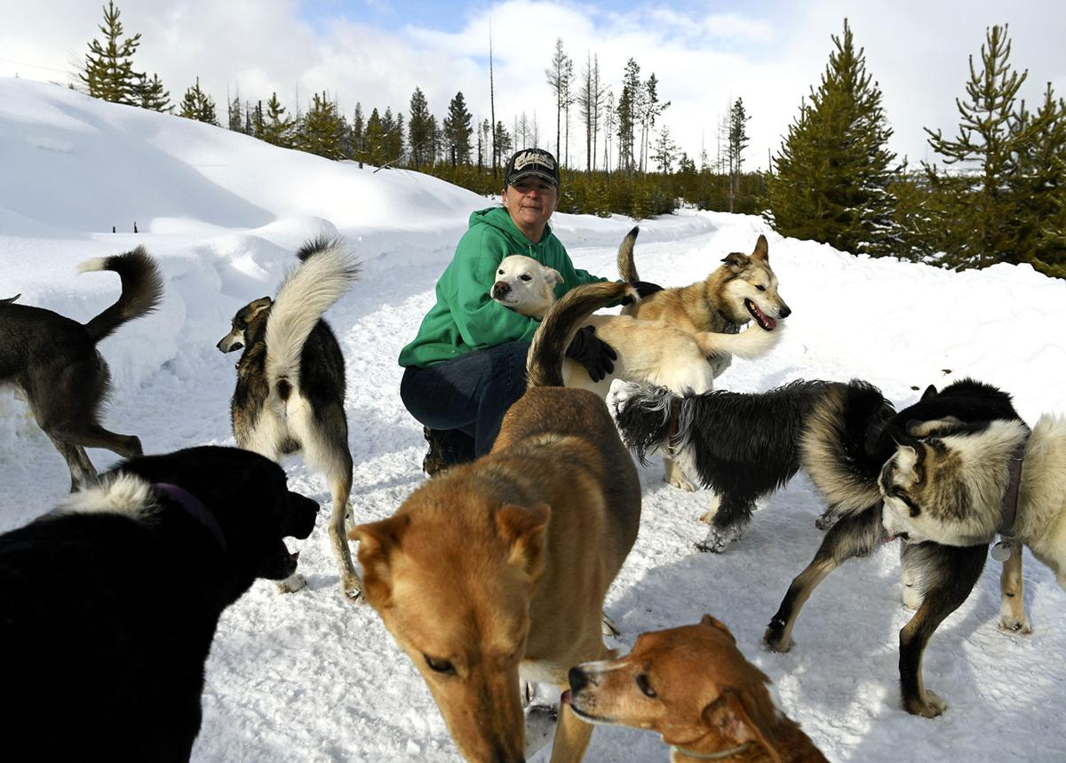 Jessie Royer with dogs at Place Lake