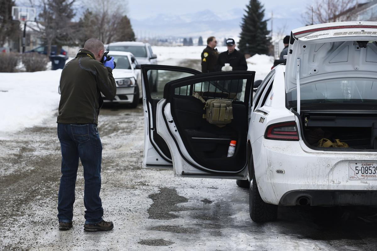 Investigators work the scene of
