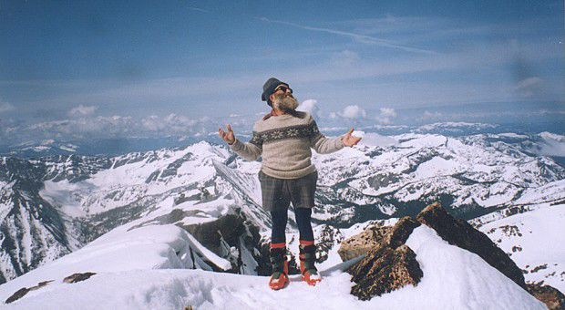 Mario Locatelli poses atop Trapper Peak