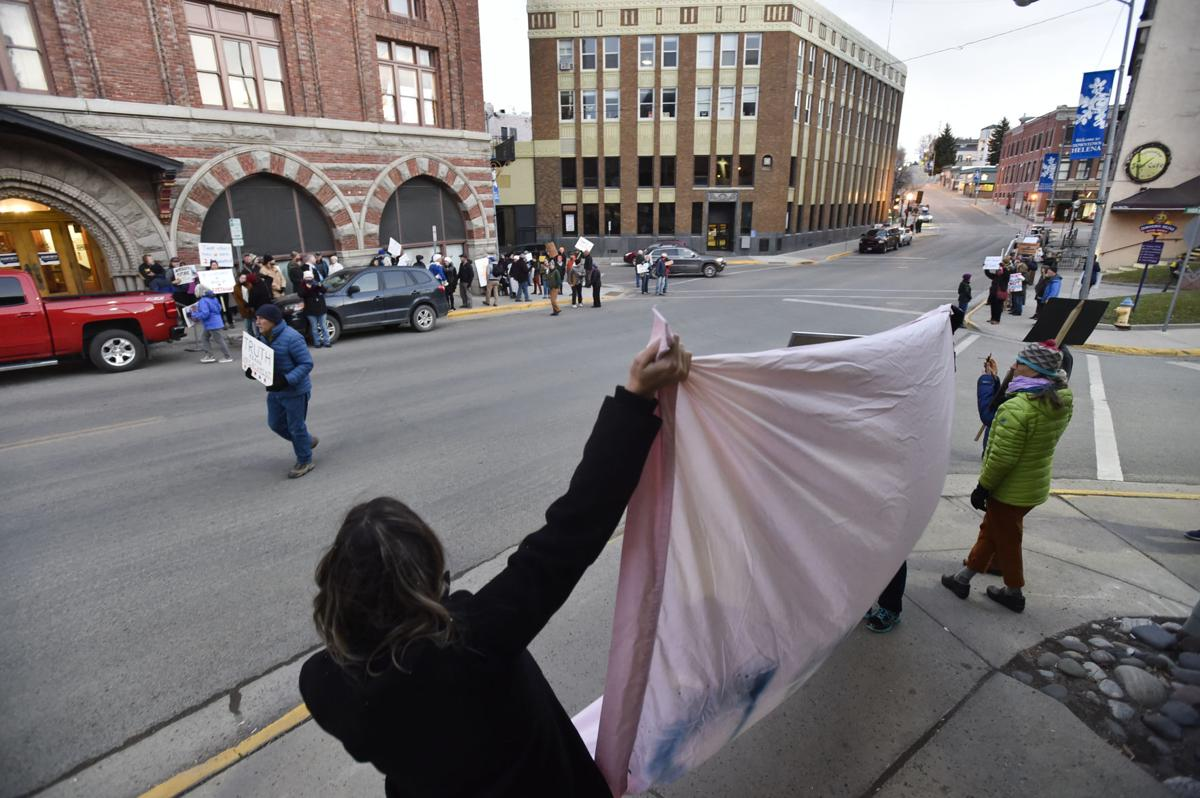 Protesters demonstrate outside the Montana Club