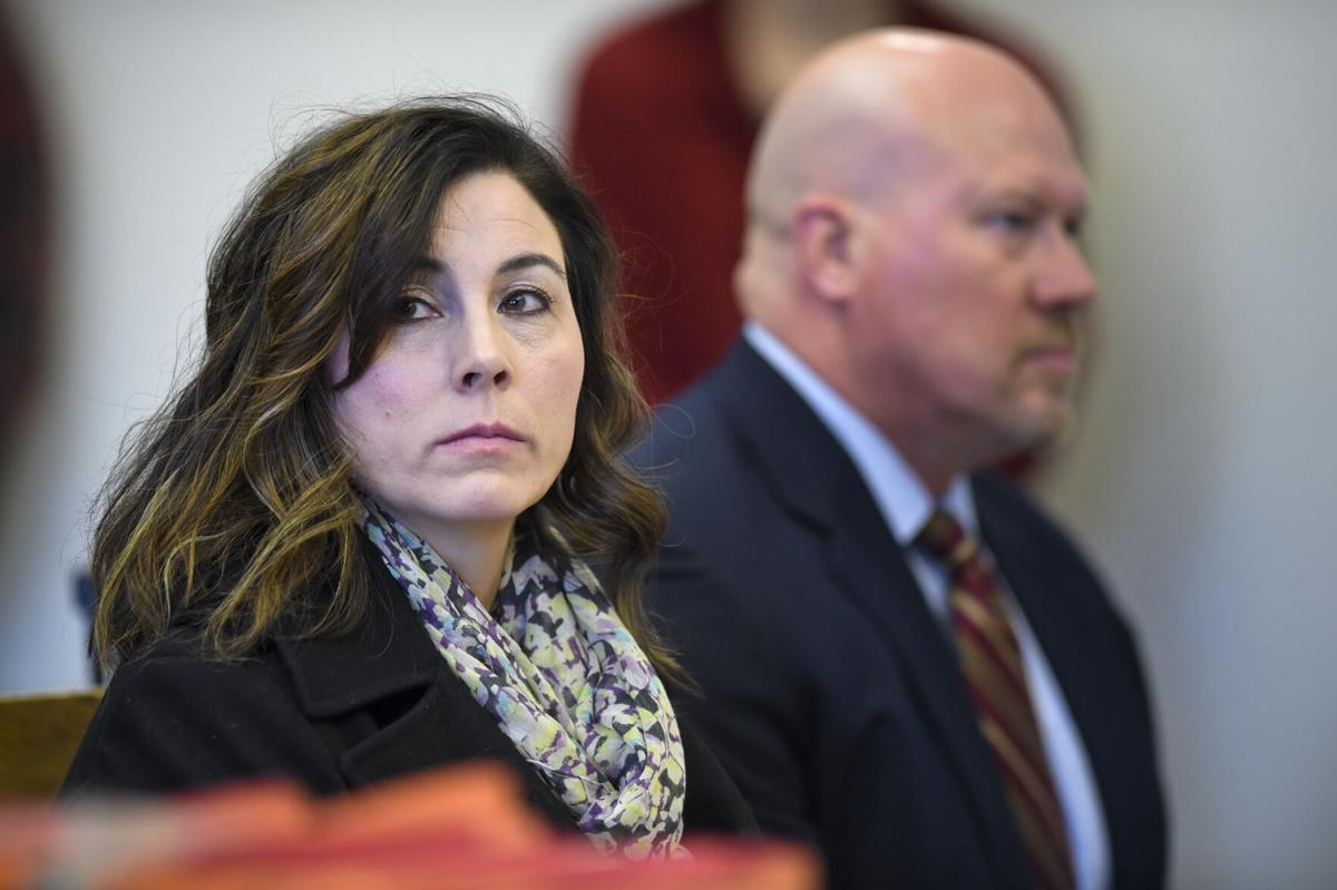 Former Capital High School Rene Carter, left, appears with her lawyer