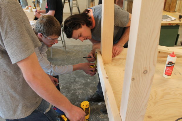 Cabinet making class builds puzzle tables