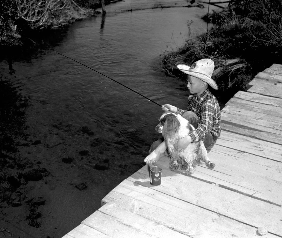 Ernst boy fishing with dog