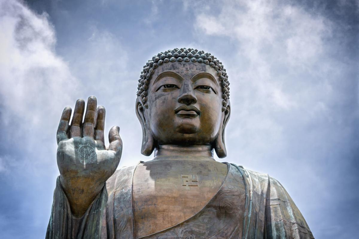 Portrait of a giant seated Buddha, stock