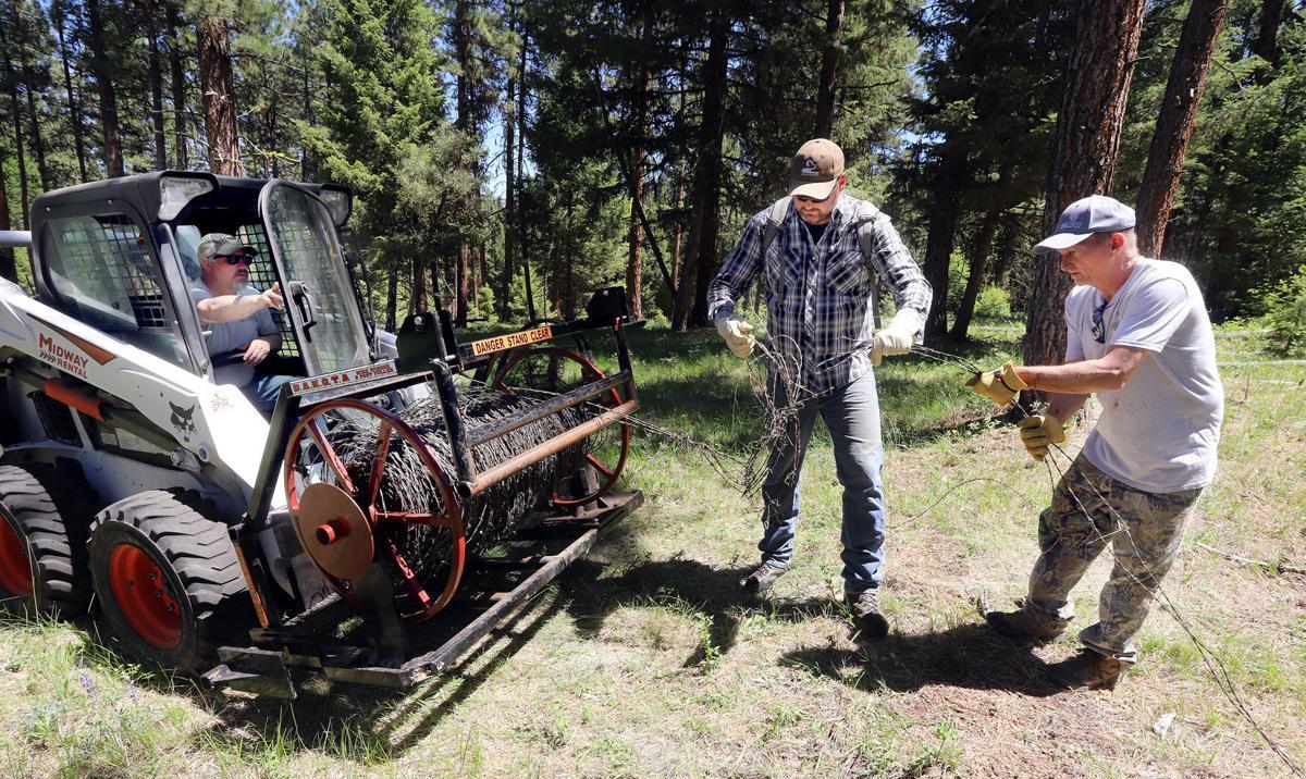 Fence down: Mule Deer Foundation volunteers remove miles of old fence