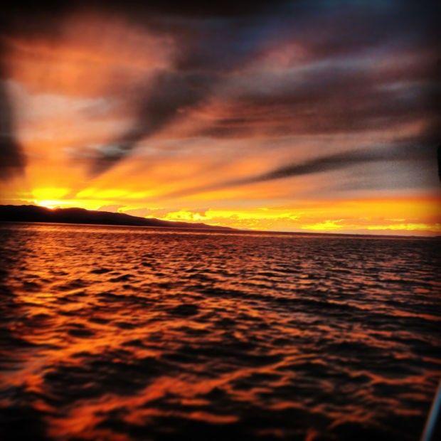 The sun sets over Flathead Lake