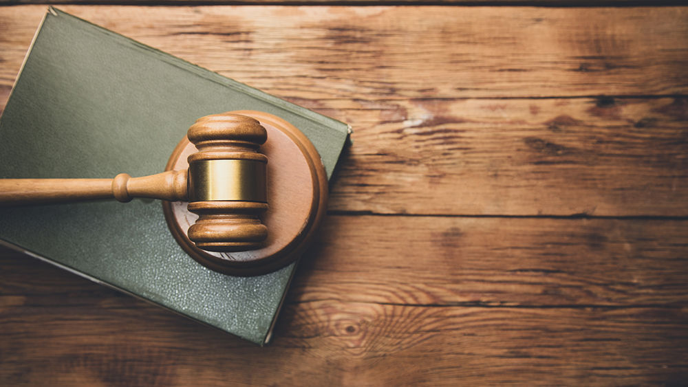 law book with a wooden judges gavel