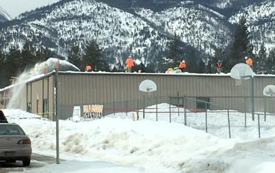 Crews clear snow off Florence-Carlton school building