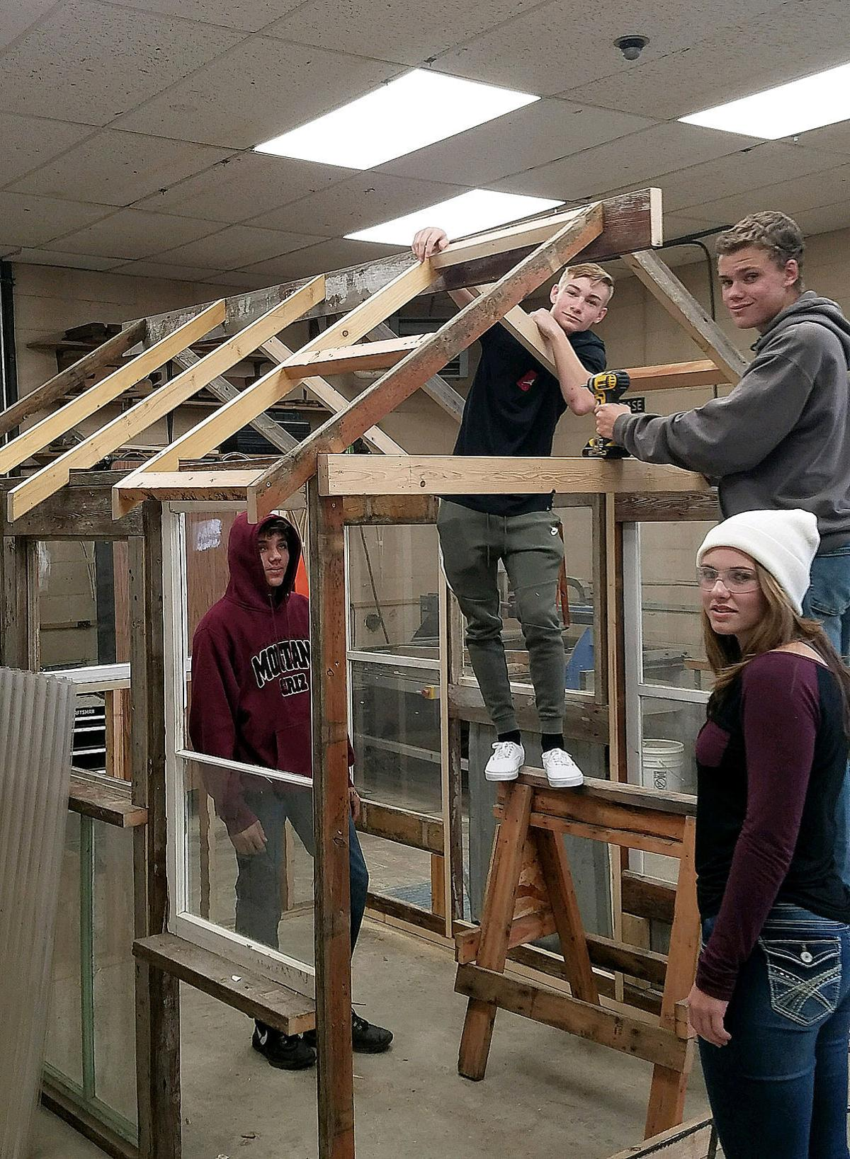 DHS student working on a greenhouse