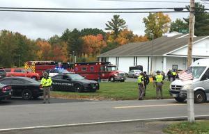 The Latest: Church shooting suspect stepson of slain cleric