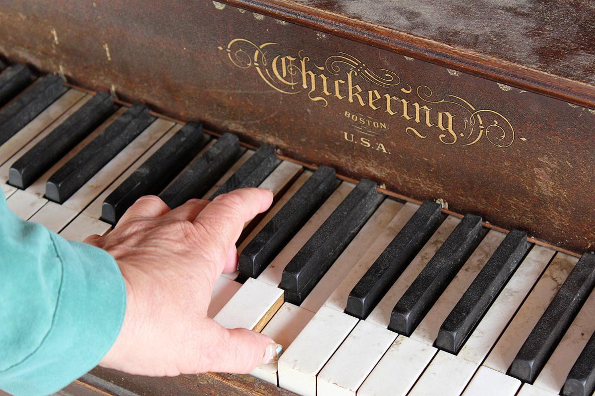 Darby Piano hand on keys